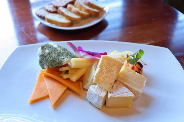 A small plate with a variety of cheeses.