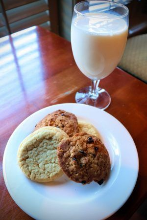 A plate of cookies and a glass of milk