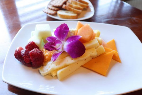 A plate of a variety of cheeses.