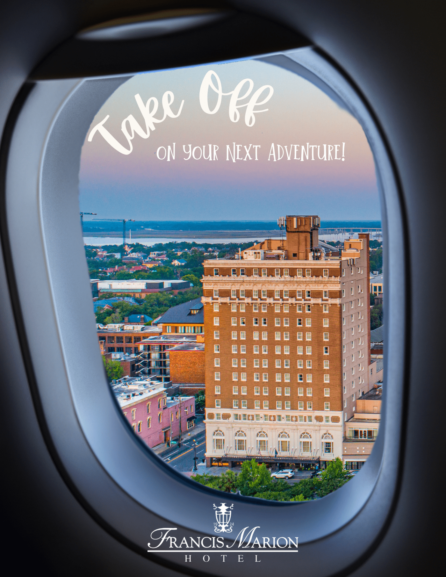 A plane window takes up the full image and outisde of the window is the city of charleston, and the Francis Marion Hotel is the main focus. The sun is setting so the building looks more orange and the sky is fading into blues and purples. The text across the image says Take off on your next adventure.